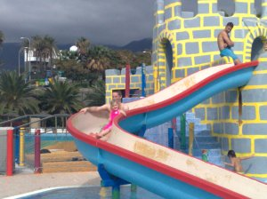 Daddy and Hannah on the castle slide in the Mini Park